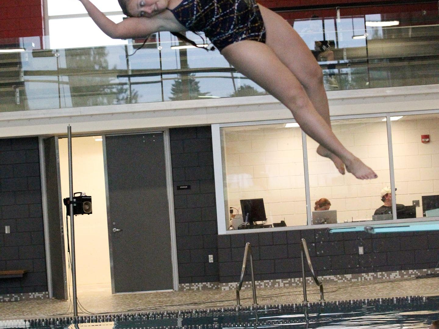 Coldwater High School diver Darien Dyer turns during a practice dive at the Dr. Robert W. Browne Aquatic Center on Sunday.