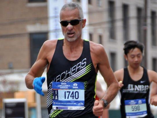 Fred Zalokar runs during the 2015 New York Marathon,
