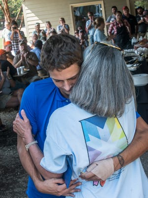 Noah Mullins, 18, of Prattville hugs Sandy Naramore, executive director for Magic Moments, on Friday, Oct 13, 2017, after finding out he was being given a deep sea fishing trip in Key West. Noah has Addison's Disease. The gift was presented during the Capital City Clay Shoot.