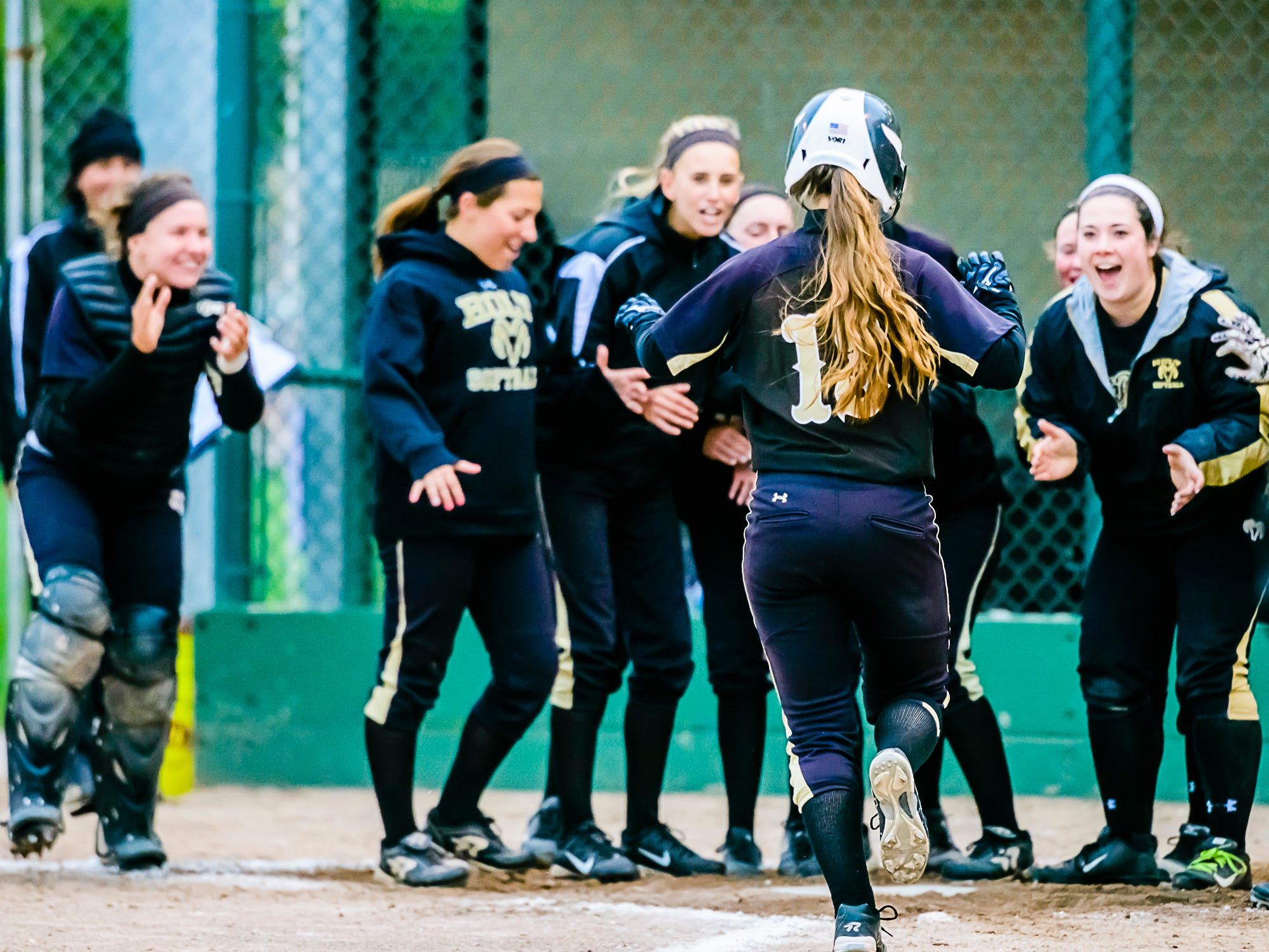 Olivia Cottom ,foreground, of Holt is greeted by her teammates after hitting a solo homerun in the 2nd inning of the Rams' Softball Classic championship game with St. Johns Tuesday May 19, 2015 at Ranney Park in Lansing. KEVIN W. FOWLER PHOTO