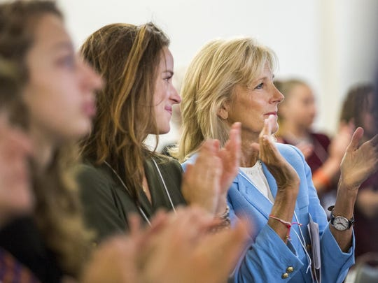 Jill Biden, wife of Vice President Joe Biden, and her daughter Ashley (left) give a standing ovation after inmate Amanda Lemon's speech at the TEDx Wilmington Salon event held at the Baylor Women's Correctional Institution on Friday morning.