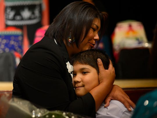 Melinda Danforth gets a hug from her son Everett James Danforth, 8, during the Oneida Nation's inauguration ceremony Thursday at the Radisson Hotel and Conference Center in Ashwaubenon. Danforth was elected as vice chairwoman.