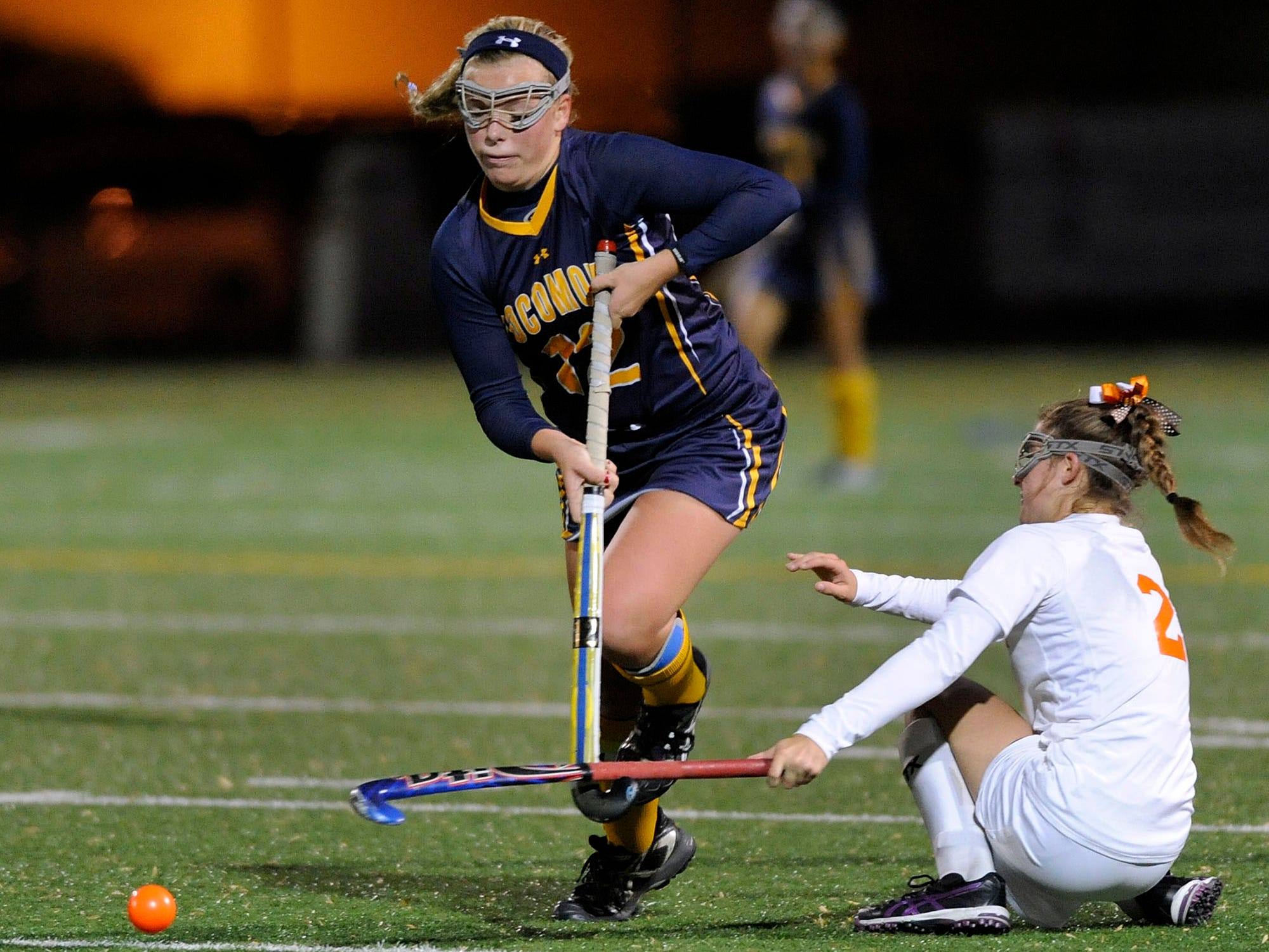 Pocomoke's Lexi Butler, left, moves past Fallston's Kylie Ryan in the second half of a state semifinal field hockey game Monday, Nov. 3, 2014 in Annapolis. (Photo by Steve Ruark for The Daily Times)