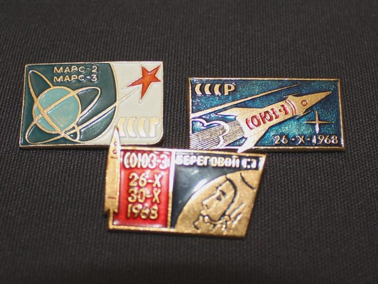 Several vintage space pins from the Soviet Union/Russia.