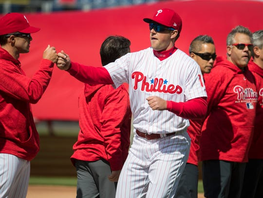Phillies' Rhys Hoskins enters the field during player