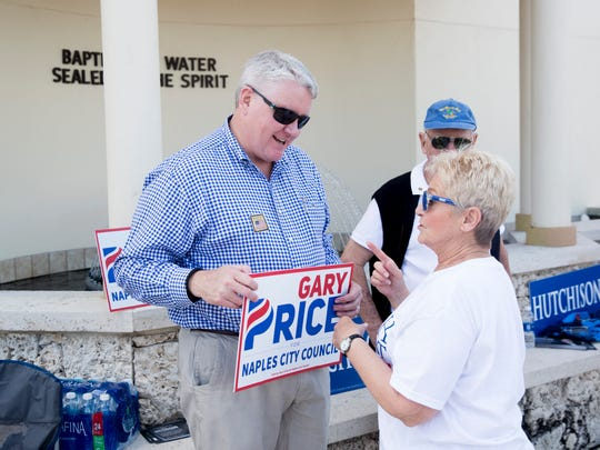 Naples City Council candidate Gary Price, left, speaks with residents as they make their way into Moorings Presbyterian Church to cast their ballots for the three open seats in the Naples City Council race midday Tuesday, Feb. 6, 2018, in Naples. Terry Hutchison, Gary Price, Linda Penniman and Mitch Norgart competed for the three open seats.