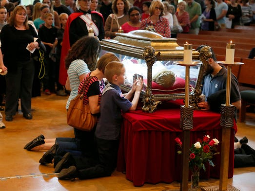 At Plymouth Catholic Church Thousands Glimpse Relics Of