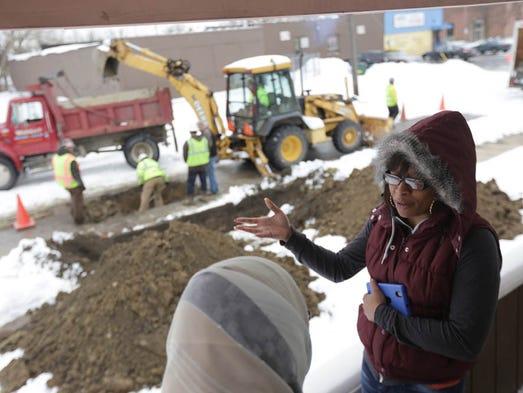 Flint resident Brittani Felton (right) talks with Jenan