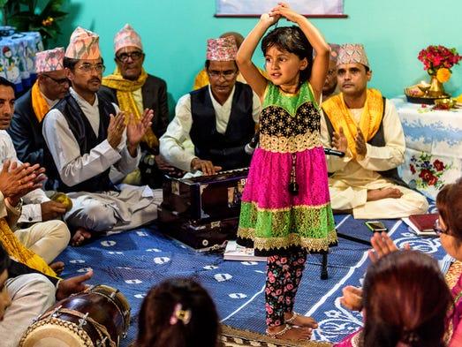 ): Shradha Humagai dance during a bhajan service of