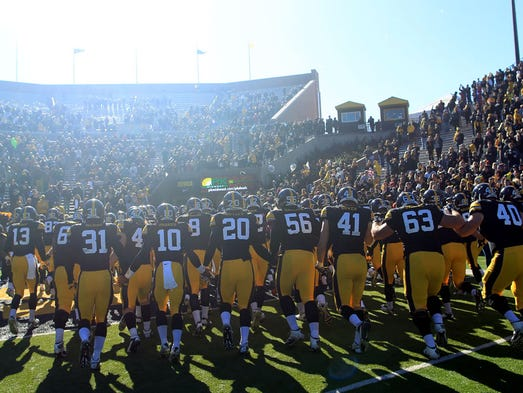 The Iowa Hawkeyes head to the locker room after their