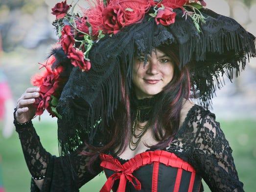 This participant displays her costume during Dia de