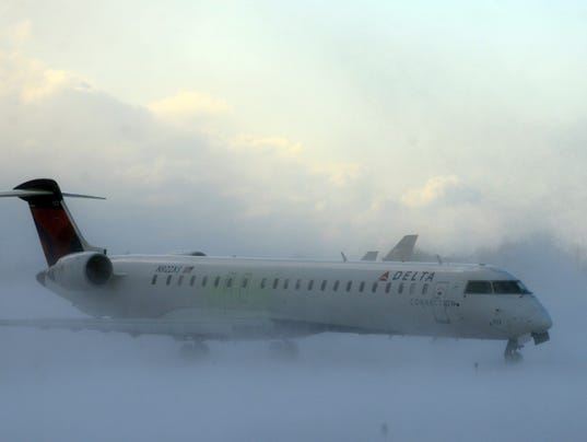 list  airlines waive change fees for thanksgiving storm