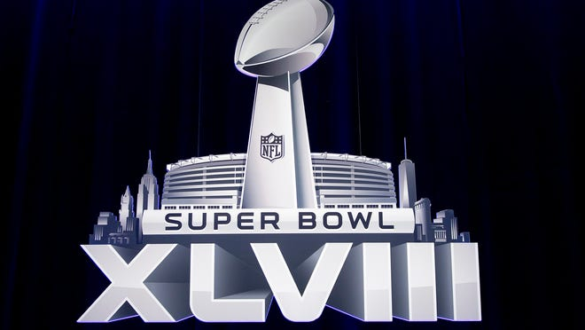 The Super Bowl XLVIII logo is pictured during a news conference ahead of the Super Bowl in New York, January 31, 2014.     REUTERS/Carlo Allegri (UNITED STATES - Tags: SPORT FOOTBALL) ORG XMIT: NYC110