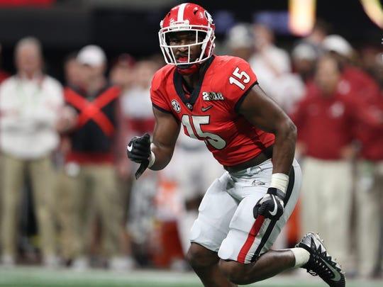 Georgia Bulldogs linebacker D'Andre Walker (15) rushes the passer against the Alabama Crimson Tide on Jan. 8, 2018.