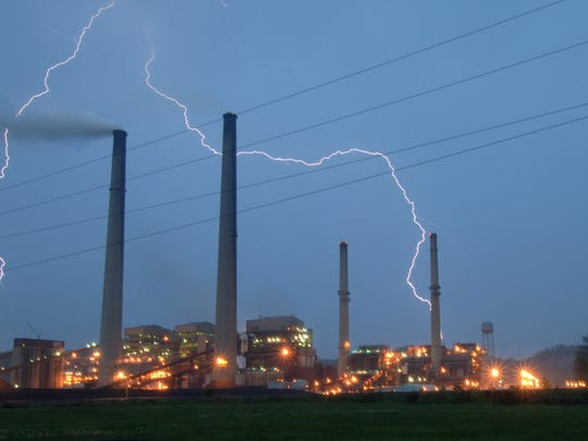 This undated photo shows the AEP Conesville Power Plant at night with lightning from a passing storm. The plant is marking its 60th anniversary with a celebration for retirees and employees on Saturday.