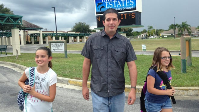 Peter Jones with his daughter Brook Jones, 11, and stepdaughter Theresa Hodgdon, leaving school at Imperial Estates elementary, in Titusville.
