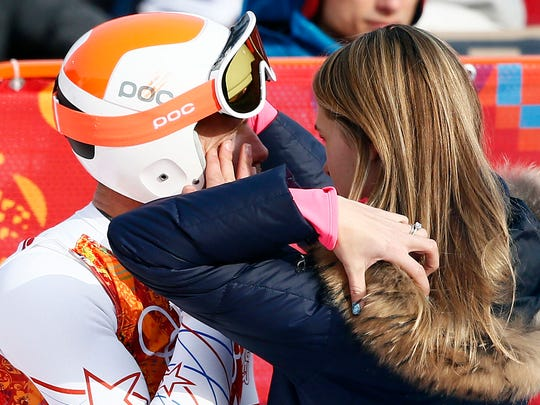 Bode Miller (USA) reacts with his wife Morgan Beck Miller after competing in men's alpine skiing super-G during the Sochi 2014 Olympic Winter Games at Rosa Khutor Alpine Center.