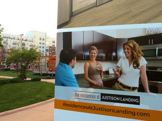 An advertisement for living at Wilmington's Riverfront is nestled next to apartments at Justin Landing.