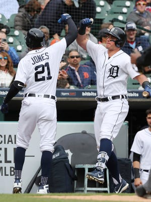 Detroit Tigers' JaCoby Jones is congratulated by teammate James McCann, right, after hitting a solo home run during the sixth inning of a baseball game against the Kansas City Royals, Saturday, April 21, 2018, in Detroit. (AP Photo/Carlos Osorio)