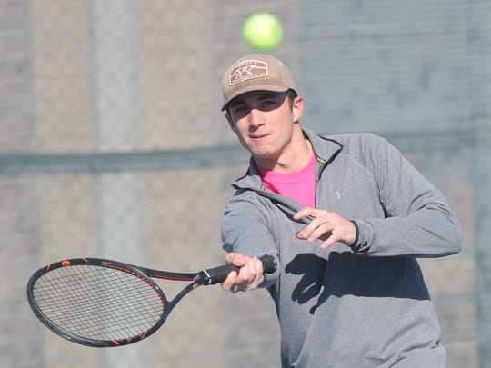 Justin Riley, a firefighter with the Abilene Fire Department, hits a shot during his doubles match against Cooper senior Liana Burris and Abilene police officer Aaron Langham. Riley teamed up with Abilene High senior Luke Phillips for the AHS-Cooper Hurricane Harvey relief fundraiser Saturday, Jan. 27, 2018 at Rose Park Tennis Center.