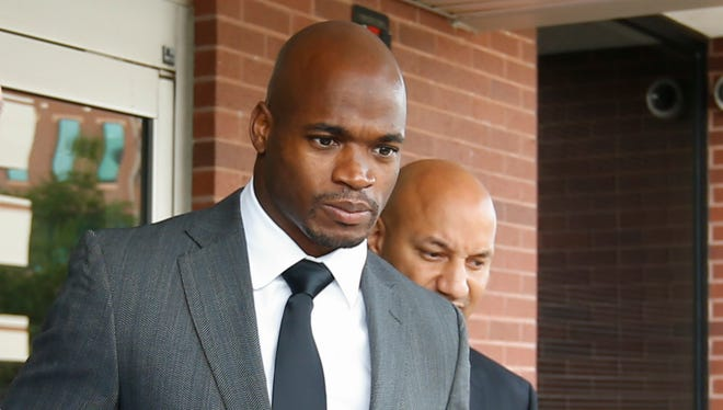 Adrian Peterson leaves the Montgomery County courthouse after his arraignment.