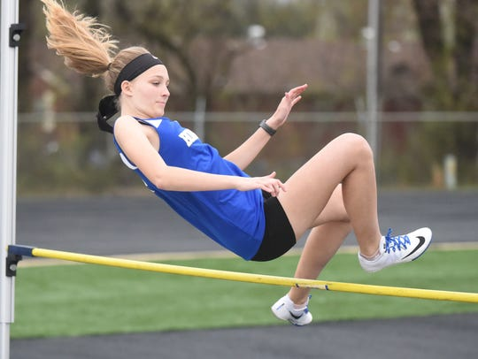 Britney Jenkins clears the high jump bar.