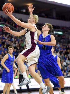 Madison's Mason Leighton goes up for a shot while Sioux Falls Christian's Lincoln Unruh defends during the 2017 SDHSAA Class A boy's basketball semifinals at the Denny Sanford Premier Center on Friday, March 17, 2017.