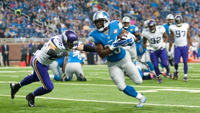 Minnesota Vikings free safety Harrison Smith (22) tackles Detroit Lions running back Theo Riddick on Oct. 25, 2015.