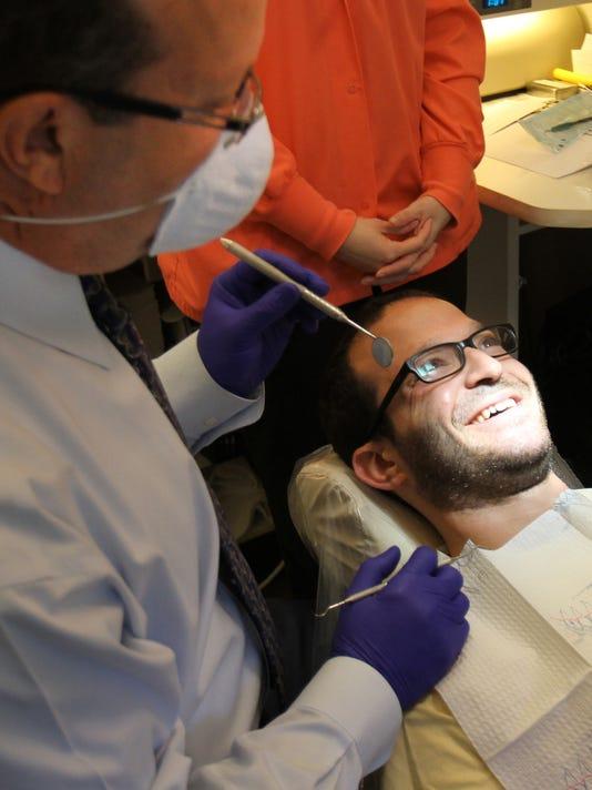 smiling patientDENTALHEALTH0805A.jpg