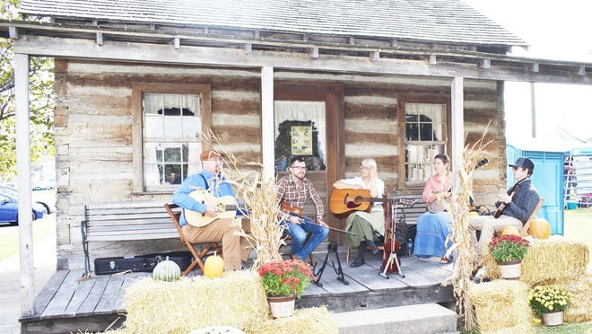 In this Neosho Daily News file photo, pickers are shown providing music at a previous History Alley event.