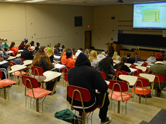 Northwestern State University professor Michael Land leads students in a biology lecture Monday.