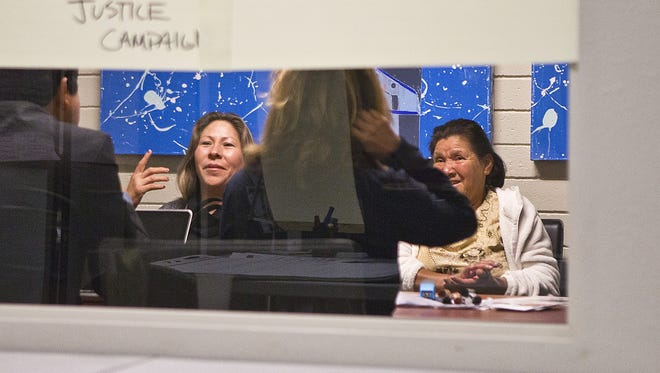 The U.S. government will pay $1 million to the family of Anastasio Hernandez Rojas, 42, an undocumented immigrant killed in 2010 by border agents near San Diego.   Here, attorneys and activists discuss the death  with Hernandez Rojas' widow, Maria Puga (left), and his mother, Maria Rojas (right).