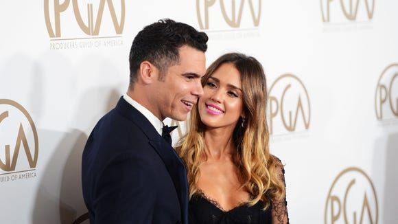 Jessica Alba, right, and husband Cash Warren are expecting