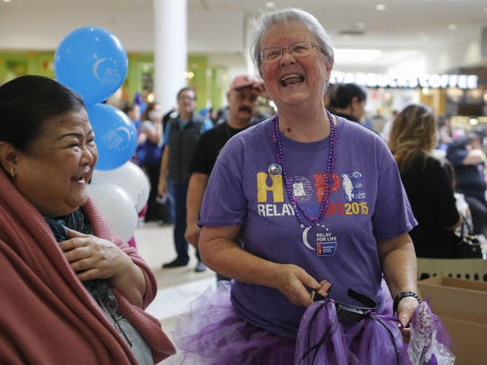 Cancer survivor Jackie Gash, center, laughs as she speaks with a woman during an American Cancer Society Relay For Life of Salinas fundraising event at Nothridge Mall on Saturday, January 30, 2016 in Salinas, Calif. Vernon McKnight/for The Californian