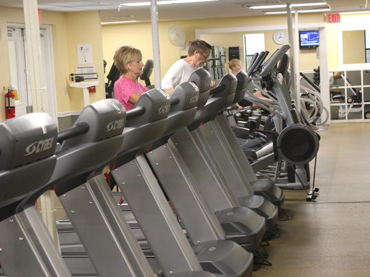 Y member Keely Stiner tests out one of the new treadmills