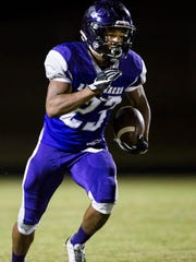 Walhalla junior Adrian Massey returns the punt against Crescent.