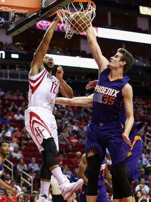 Dec 26, 2016: Houston Rockets guard Eric Gordon (10) dunks the ball as Phoenix Suns forward Dragan Bender (35) defends during the second half at Toyota Center.