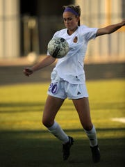 Wylie's Jacqueline Williams (20) runs down a ball during the second half of the Lady Bulldogs' 12-0 win in the Region I-4A bi-district soccer game on Thursday, March 22, 2017, at Wylie's Bulldog Stadium.