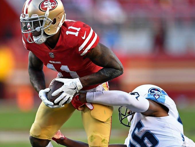 Titans cornerback LeShaun Sims (36) tackles 49ers wide