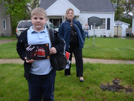 Levi Boling and his mother, Susan Bortz rode to school