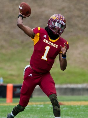 Tuskegee quarterback Kevin Lacey throws against Lane in Tuskegee, Ala., on Saturday September 24, 2016.