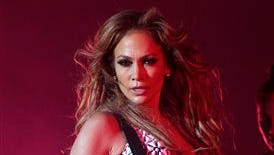 FILE - In this May 29, 2015, file photo, Jennifer Lopez performs on stage at Morocco's biggest music Mawazine Festival in Rabat, Morocco. Lopez is taking on hosting duties at the American Music Awards, on Nov. 22, 2015. Producers say Lopez will host and perform at the show, set to be broadcast live on ABC from the Microsoft Theater in Los Angeles. (AP Photo/Abdeljalil Bounhar, File)