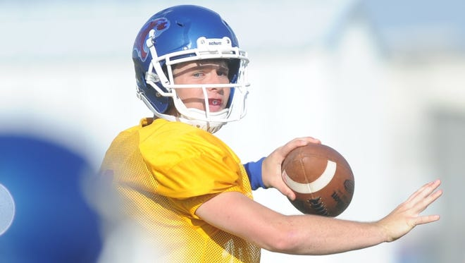 Cooper quarterback Ender Freeman looks to throw the ball during practice Monday, Aug. 28, 2017 at the Cooper practice field.