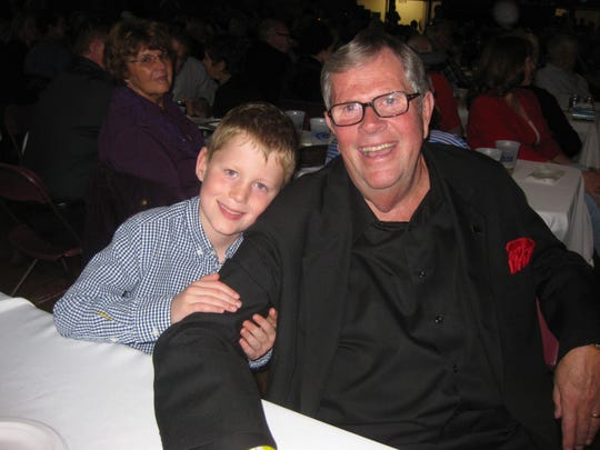 Ed Dougherty sits with his grandson, Eddie J. Dougherty, at a celebration Oct. 20, 2012 at Salem Armory marking the 50th anniversary of the first event the elder Dougherty staged and promoted.