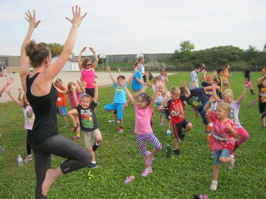 Spring Road Elementary School recently held its Activity Day. Students enjoyed nine activity rotations that included yoga, parachutes and relays, as well as math and literacy games with an exercise element.