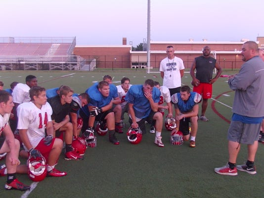 Pequea Valley head coach Mike Choi addresses his team after a summer practice.