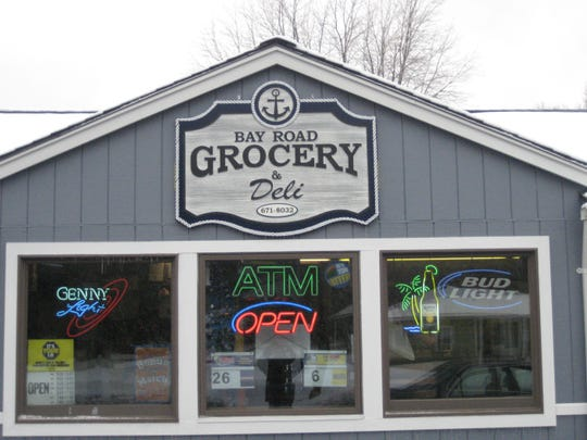The storefront for Bay Road Grocery & Deli.