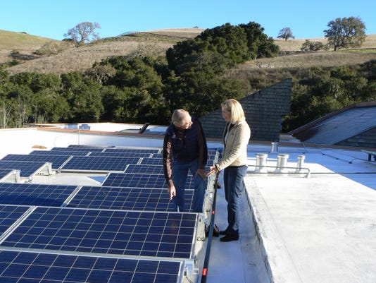 Tim Knapp and Pastor Linda McConnell discuss new solar panels at Church of t (3)