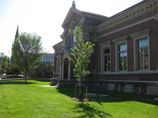 A recent view of the Fletcher Free Library in Burlington with the Carnegie building on the right and the 1981 addition on the left.
