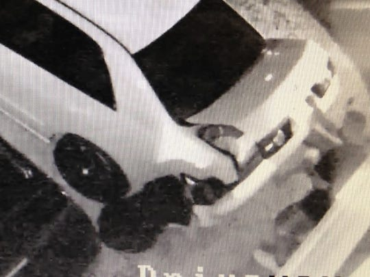 Surveillance images captured two suspects in a vehicle